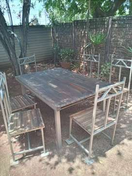 Steel table with beautiful wooden top & 6 steel chairs with wood