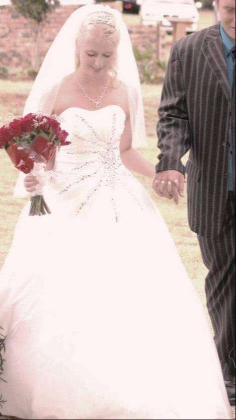 Wedding dress and petty coat for sale 0