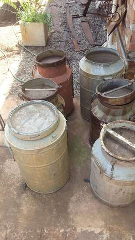 Assorted Antique Milk and Cream Cans Watering Cans Buckets