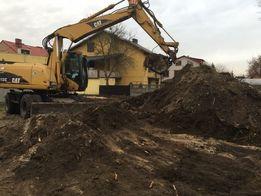 Koparka prace ziemne wykopy pod fundamenty niwelacje terenu piasek