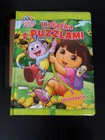 Książka z puzzlami ''Dora poznaje świat''