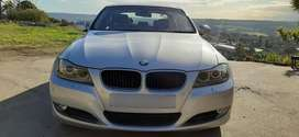 BMW e90 320i. Has a sunroof, navigation, PDC and full service history