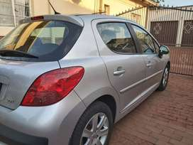 Peugeot 207, 2006 model, silver in color, 156000km, accident free..