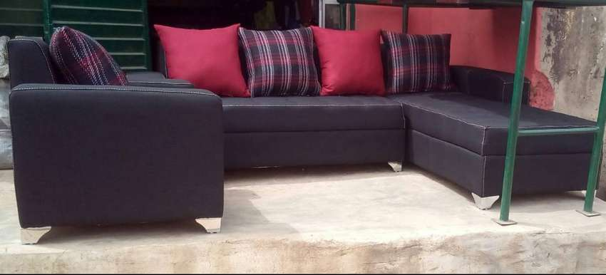 L-shape sofas and a single chair, 7 seater couches. Black fabric 0
