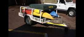 Trailer and kayak with rooftop tent