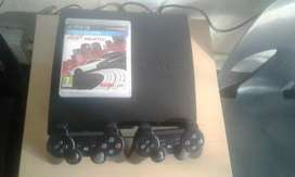 Ps3 with 2 games and 2 counsels
