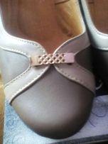 Шкіряні нові туфлі