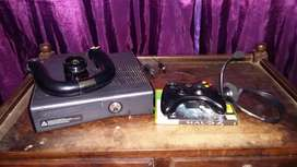 X-box 360 plus controller and steering wheel, and one game