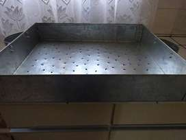 galvanized container with holes