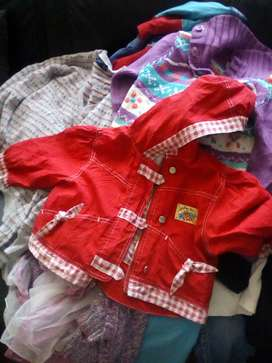 Mixed bag of children's clothes and ladies clothes in a big plastic