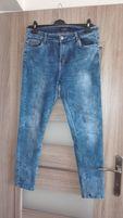 Marmurkowe jeansy XL