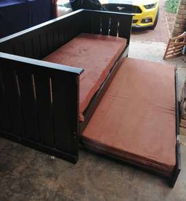 Day bed /couch with pull out extra single bed plus mattresses