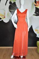 Pomarańczowa długa suknia z rozcięciem, zwiewna, idealna na wesele