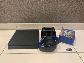 PS4 with 5 Games + Accessories