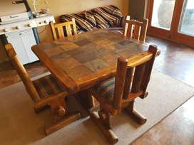 Solid dining room with 4 chairs available.