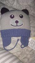 Продам детскую шапку на зиму