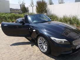 It is a 3.0si Roadster automatic . The car is a convertible -2 door