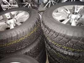 """18"""" Isuzu Rims and 255/60/18 General grabber AT tyres for r14500."""