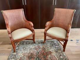 Set of 2 rottang wingback chairs.
