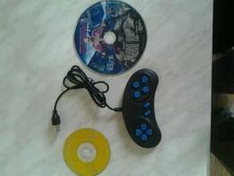 Игровой джойстик и три диска с играми