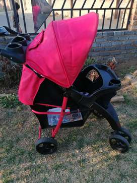 Bounce pram red, black and white in colour still in a good condition.