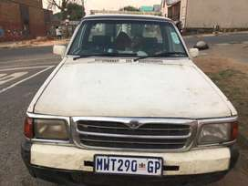 2000 ford courier towing van, 2.2 engine capacity, 2doors, white colou