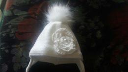 Продам зимнюю шапочку на новорожденную