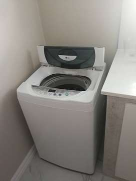 Russell hobs double door fridge and LG top loader washing machine