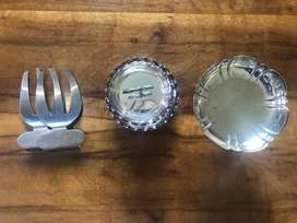 Silver bowls and salad servers