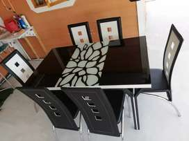 Brand new Glass Dining table with 6 chairs of excellent quality.