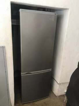 White double fridge and single grey fridge