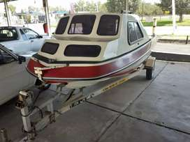 Sportster fishing cabin boat with 75Hp Yamaha Motor on trailer