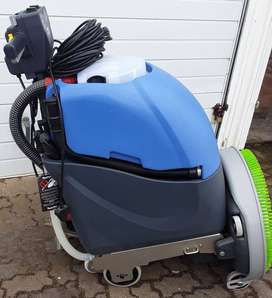 Up for grabs are 2 industrial vacuum cleaners and floor scrubber