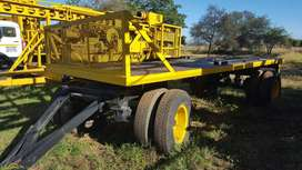 Flat deck heavy duty farm trailer.