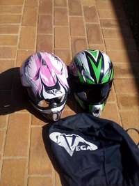 Image of both helmets size m pink and green size s 250