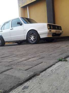 "Its a white VW Golf TenaCiti with sound and 15""mags on it.I"