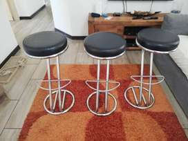 Chrome bar stools , with black leather seat