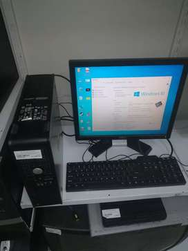 Dell computer with mouse and keyboard and power cable