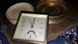 Old clock and round powder mirror antiques