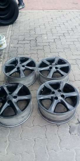 15 inch set of black Toyota Tazz in very good condition pcd 4/100