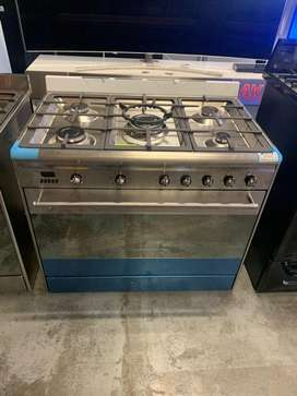 SMEG STAINLESS 5BURNER GAS STOVE AND ELECTRIC OVEN