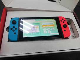 Nitendo Switch with Red & Blue Joy Cons, excellent condition as new +
