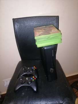 Xbox 360 with 4 games and 2 wireless controllers