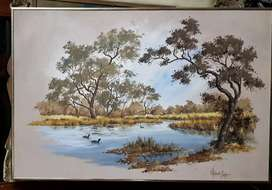 Various vintage paintings depicting scenes of nature and tranquility
