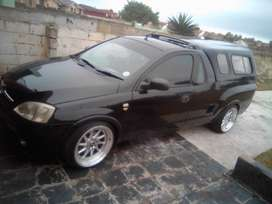 Black sports bakkie...in good condition inside and outside. Good looks