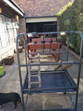 Cage, trolley and stand for sale.