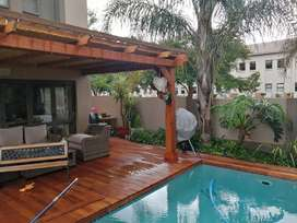 Pergola, wooden decking and swimming pools