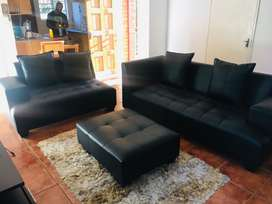 Lovely black Leather Couch with Coffee table