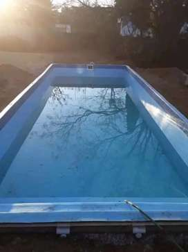 SWIMMING POOLS AND THATCHING