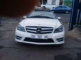 2012 Mercedes Benz C180 AMG Sport with a leather seat and sunroof